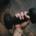a hand holding a bar bell weight
